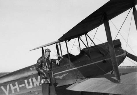 Squadron Leader Alex Kynoch with his Tiger Moth