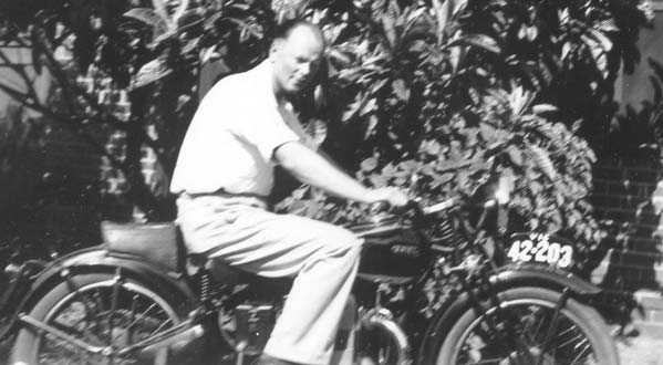 Alex & his Douglas motorcycle in the backyard